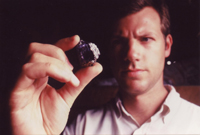 Eric Saul holding a huge Tanzanite rough stone