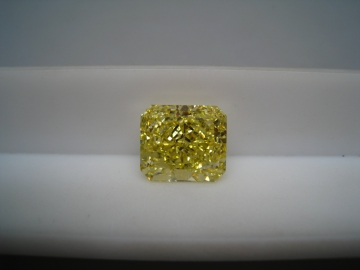 Natural-Fancy-Vivid-Yellow-Even-VS2-VG-VG-Fluo-None 25.9 Cts